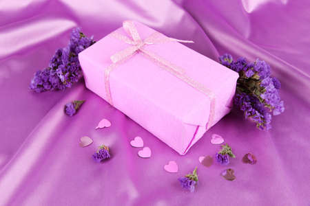 Romantic parcel on purple cloth background photo