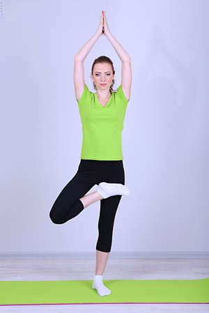 Portrait of beautiful young woman exercises photo