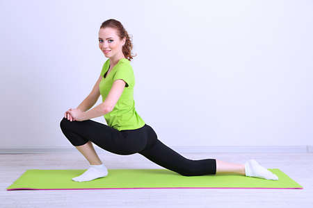 asanas: Portrait of beautiful young woman exercises