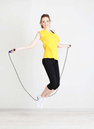 skipping: Beautiful young woman with  skipping rope
