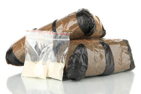 drug deals: Packages of  narcotics isolated on white