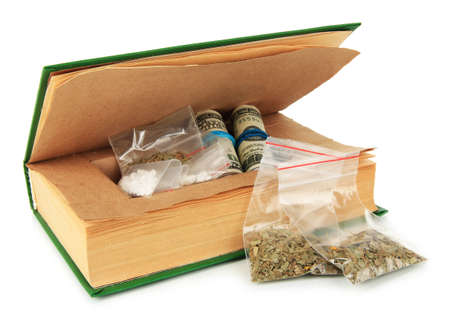 narcotics: Narcotics in book-hiding place isolated on white Stock Photo