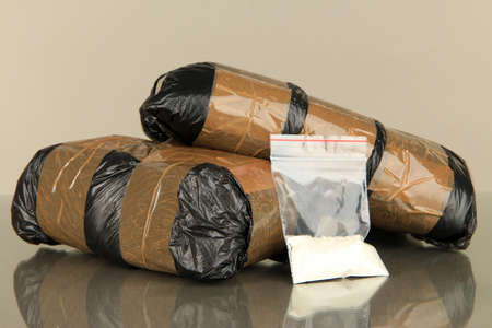 Packages of  narcotics on gray background photo