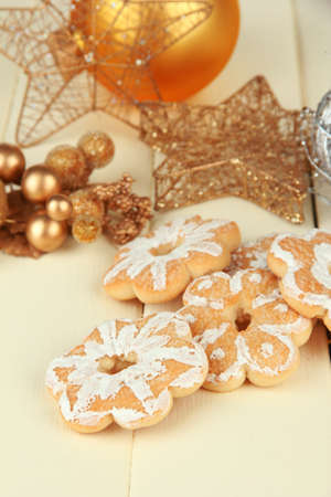 Christmas cookies and decorations on color wooden background Stock Photo - 20517958