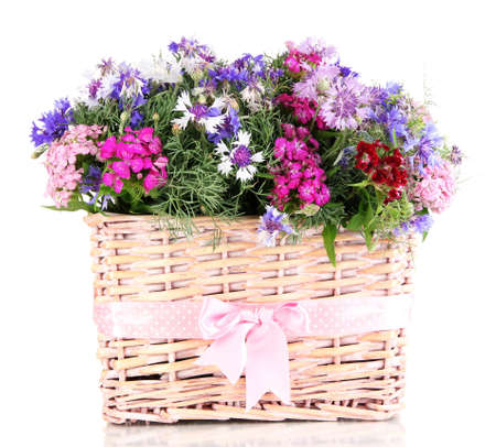 Beautiful bouquet in basket isolated on white photo