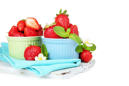 Ripe sweet strawberries in bowls, isolated on white photo