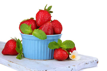 Ripe sweet strawberries in bowl, isolated on white photo