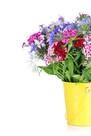 Beautiful bouquet in pail isolated on white photo