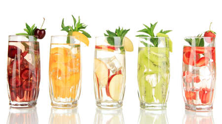 fruit drinks: Glasses of fruit drinks with ice cubes isolated on white