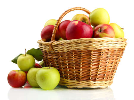 fruits basket: juicy apples with green leaves in basket, isolated on white