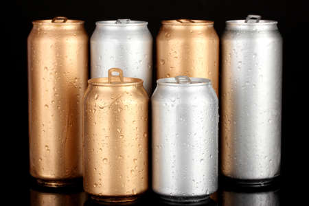 Aluminum cans with water drops isolated on black photo