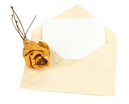 Old envelope with blank paper and dried rose from autumn leafs isolated on white photo