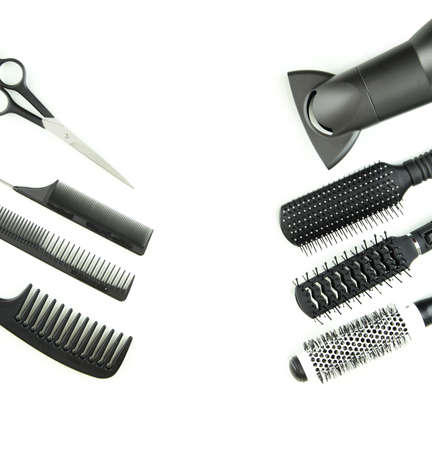 hairbrush: Comb brushes, hairdryer and cutting shears, isolated on white