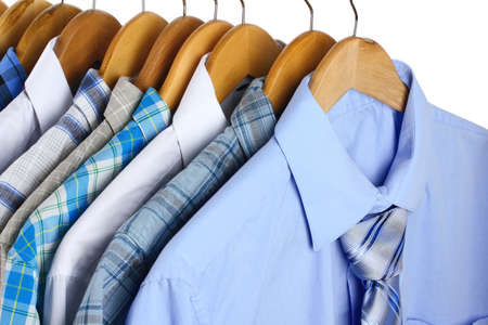 Shirts with ties on wooden hangers close-up Stock Photo - 20649548