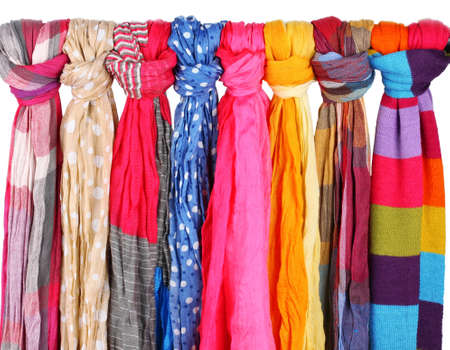 multiple personality: Many bright female scarfs isolated on white Stock Photo