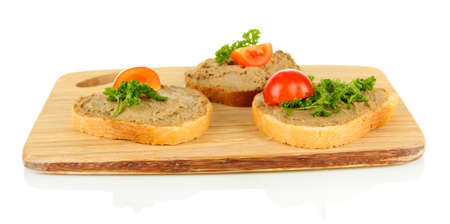 Fresh pate on bread on wooden board, isolated on white photo