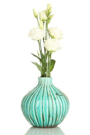 flower vase: Bouquet of eustoma flowers in vase isolated on white Stock Photo
