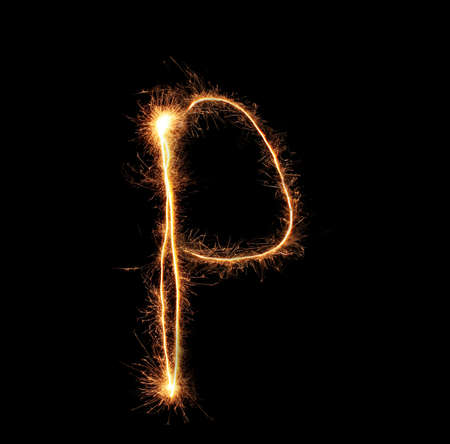 Letter P sparklers on black background photo