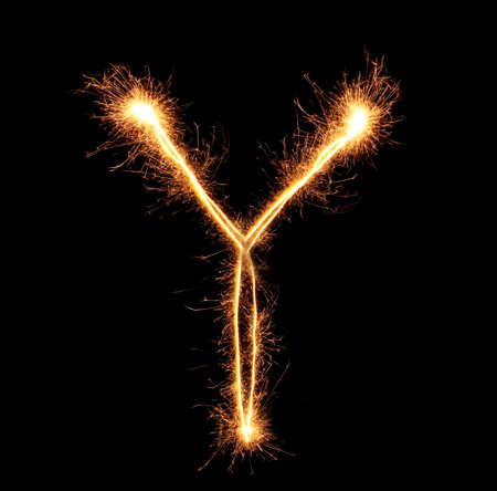 Letter Y sparklers on black background photo