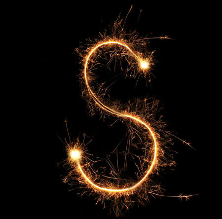 year s: Letter S sparklers on black background