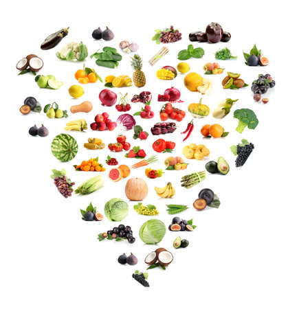 Heart made from various fruits and vegetables isolated on white photo