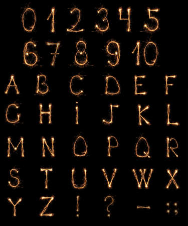 Alphabet and Numbers sparklers on black background photo