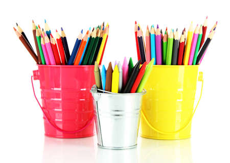 hued: Colorful pencils in three pails isolated on white