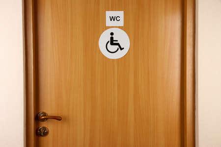 Toilet sign on wooden door photo