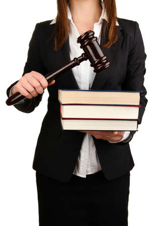 adjournment: Woman holding wooden gavel and law books isolated on white Stock Photo