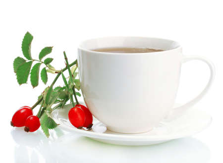 cup of tea with hip roses, isolated on white photo