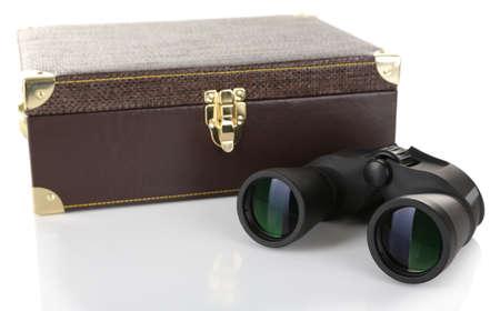 Black modern binoculars with suitcase isolated on white photo