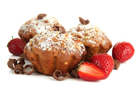 Tasty muffin cakes with strawberries and chocolate, isolated on white photo