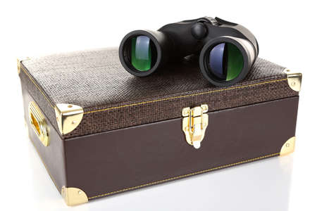 Black modern binoculars with suitcase isolated on white photo