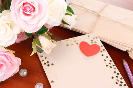 odd jobs: Writing letter of congratulations to mothers Day on wooden table close-up
