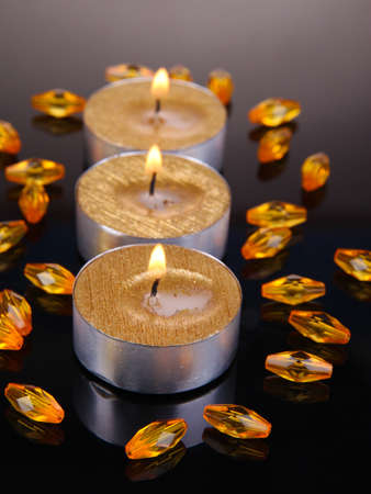 unlit: Golden candles isolated on black Stock Photo