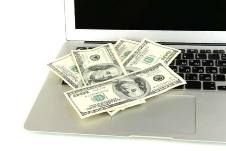 Money on laptop isolated on white photo