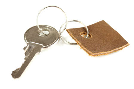 Key with leather trinket isolated on white photo