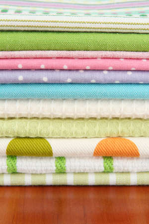 Kitchen towels, on wooden background photo