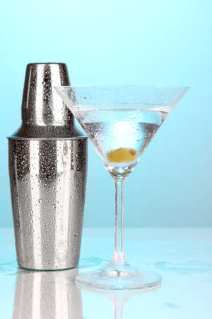 refrigerate: Shaker and cocktail on blue background