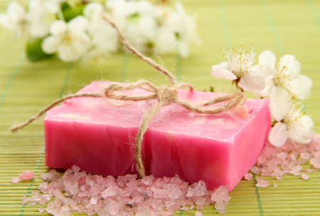 Natural handmade soap on bamboo mat photo