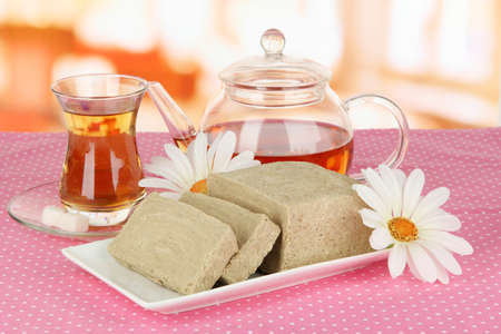 confect: Tasty halva with tea on table in room
