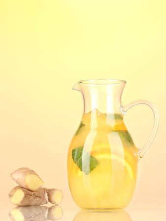 Orange lemonade in pitcher on yellow background Stock Photo - 20784423