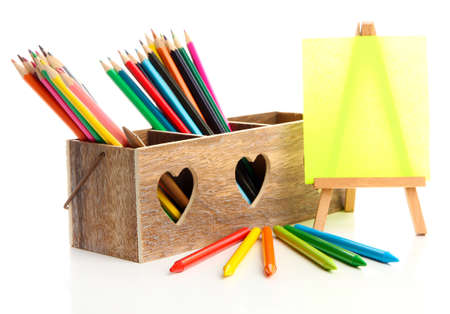 Different pencils in wooden crate and easel, isolated on white Stock Photo - 20784160