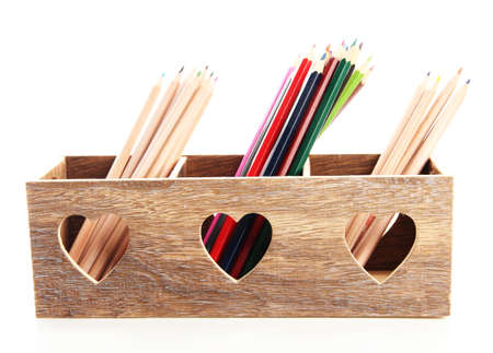 Different pencils in wooden crate, isolated on white photo