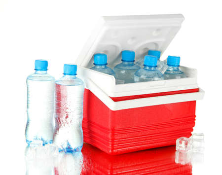 refrigerate: Traveling refrigerator with bottles of water and ice cubes, isolated on white