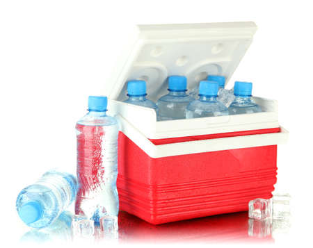 Traveling refrigerator with bottles of water and ice cubes, isolated on white photo