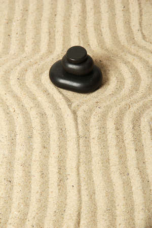 Zen garden with raked sand and round stones close up Stock Photo - 20783360