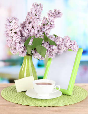 Beautiful lilac flowers on table in room Stock Photo - 20783413