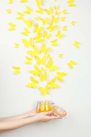 amorousness: Paper yellow butterflies fly out of bank Stock Photo