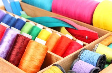 sewing box: Sewing accessories in wooden box close up Stock Photo